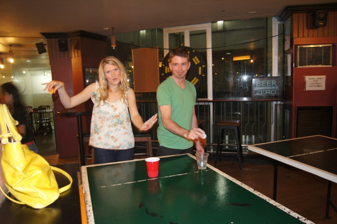 Beer pong in a bar in the Philippines.